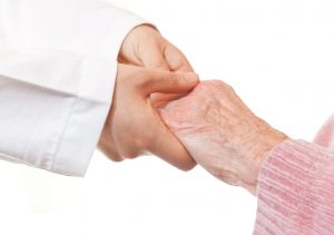9648660 - doctor holding senior's hands